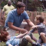 Still image from Gillette advert showing father separating fighting boys